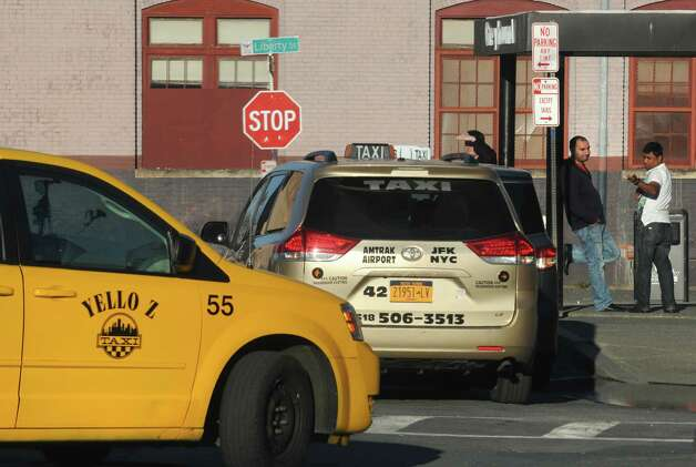 Taxis wait for passenger pick up at the Greyhound Bus terminal on Tuesday April 28, 2015 in Albany, N.Y. (Michael P. Farrell/Times Union) ORG XMIT: MER2015042820072197 Photo: Michael P. Farrell / 00031637A