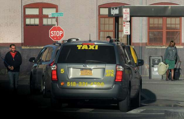 Taxis wait for passenger pick up at the Greyhound Bus terminal on Tuesday April 28, 2015 in Albany, N.Y. (Michael P. Farrell/Times Union) ORG XMIT: MER2015042820071595 Photo: Michael P. Farrell / 00031637A
