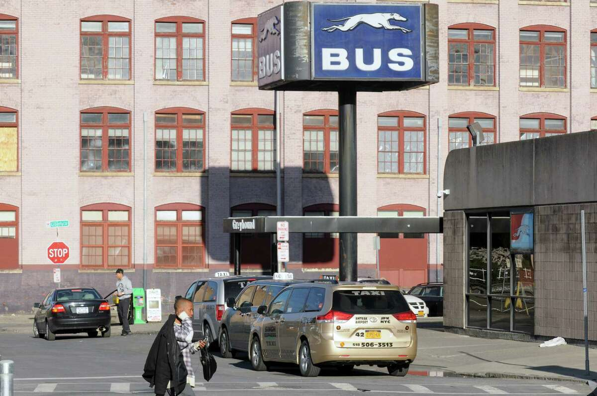 Taxis wait for passenger pick up at the Greyhound Bus terminal on Tuesday April 28, 2015 in Albany, N.Y. (Michael P. Farrell/Times Union) ORG XMIT: MER2015042820064382