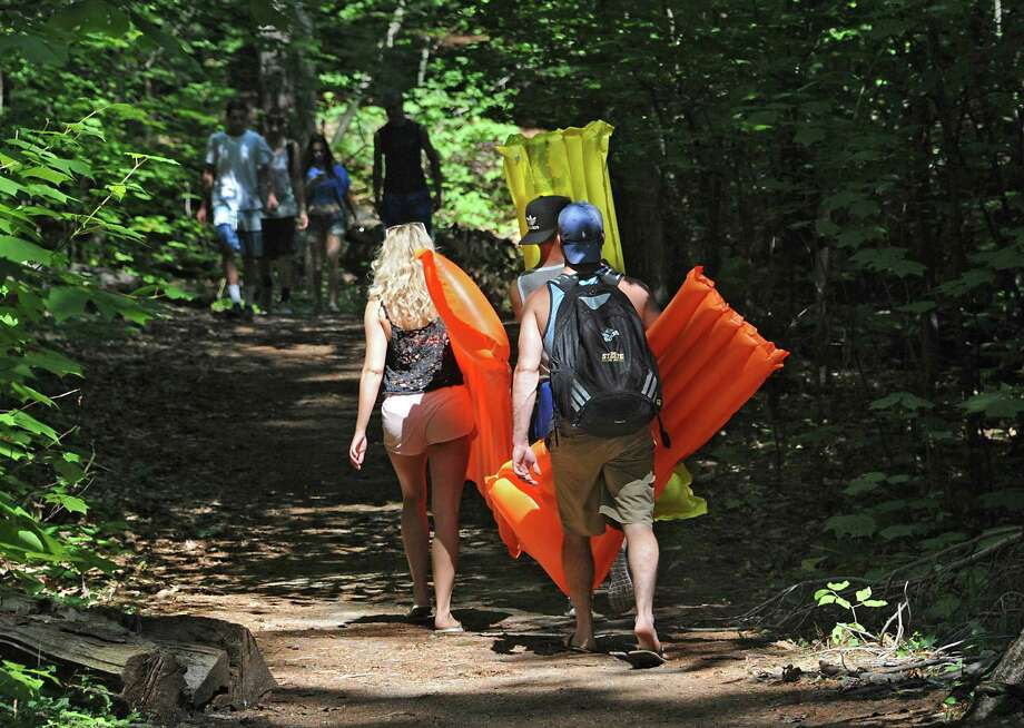 Young adults bring floats to Log Bay on Lake George on Monday, July 27, 2015 in Fort Ann, N.Y. Log Bay Day has become a tradition on the last Monday in July.  (Lori Van Buren / Times Union) Photo: Lori Van Buren / 00032750A