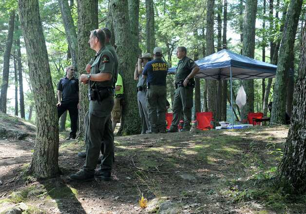 Rangers and policemen patrolled the shores of Log Bay on Lake George on Monday, July 27, 2015 in Fort Ann, N.Y. Log Bay Day has become a tradition on the last Monday in July.  (Lori Van Buren / Times Union) Photo: Lori Van Buren / 00032750A