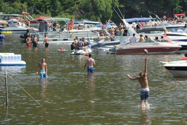 People party and swim in Log Bay on Lake George on Monday, July 27, 2015 in Fort Ann, N.Y. Log Bay Day has become a tradition on the last Monday in July.  (Lori Van Buren / Times Union) Photo: Lori Van Buren / 00032750A