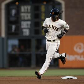 Brandon Crawford (35) rounds the bases after hitting a two-run homerun in the fourth inning as the Giants played the Milwaukee Brewers at AT&T Park in San Francisco, Calif., on Monday, July 27, 2015. The Giants