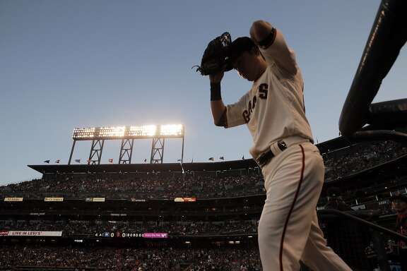 Nori Aoki (23) heads to left field from the dugout as the Giants played the Milwaukee Brewers at AT&T Park in San Francisco, Calif., on Monday, July 27, 2015. The Giants