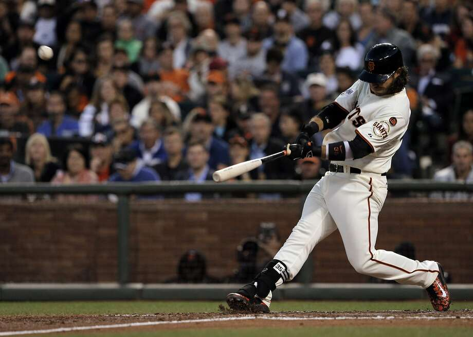 Brandon Crawford (35) hits a two-run homerun in the fourth inning as the Giants played the Milwaukee Brewers at AT&T Park in San Francisco, Calif., on Monday, July 27, 2015. The Giants Photo: Carlos Avila Gonzalez, The Chronicle