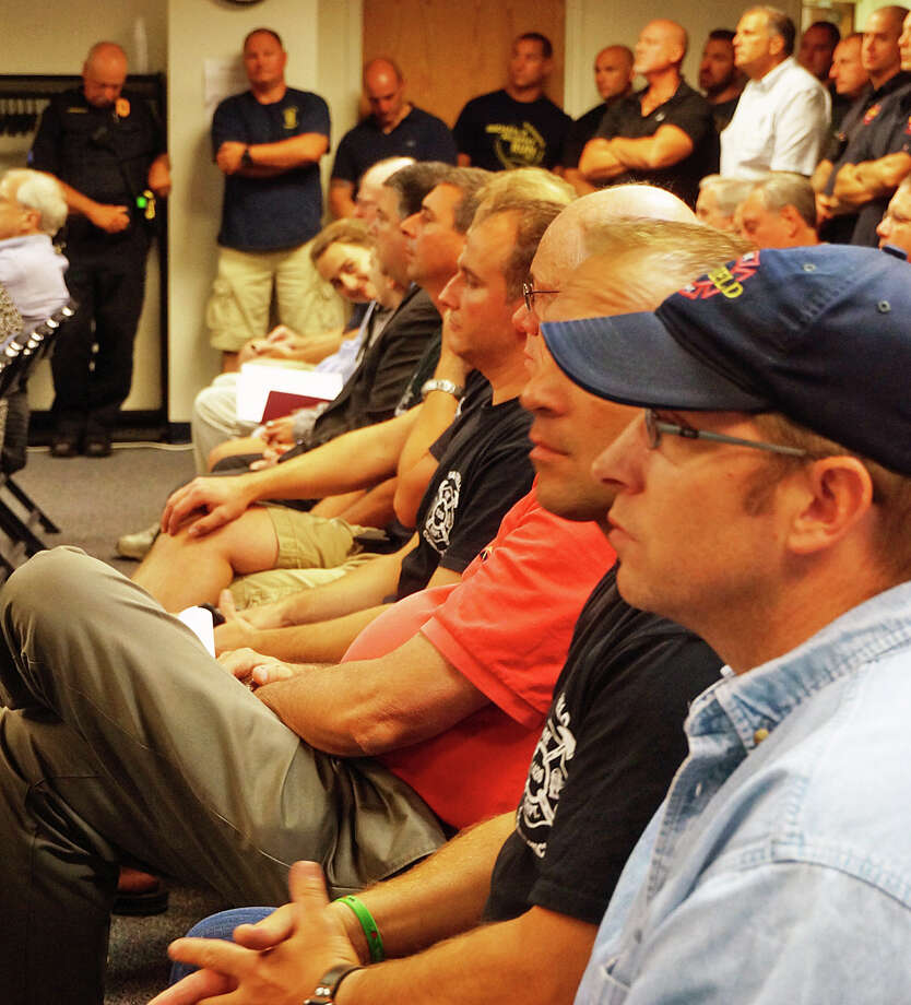 Firefighters and police officers packed Monday's Representative Town Meeting where they saw their respective contracts approved. Photo: Genevieve Reilly / Fairfield Citizen / Fairfield Citizen