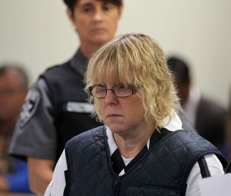 In this June 15, 2015, file photo, Joyce Mitchell appears before Judge Mark Rogers in Plattsburgh (N.Y.) City Court for a hearing. She is charged with helping Richard Matt and David Sweat escape from the Clinton Correctional Facility on June 6. While Richard Matt and David Sweat counted their final hours to freedom, prison tailor-shop instructor Mitchell was heading to a hospital with chest pains driven by a panic attack. She was leaving the hospital when she learned that Matt and Sweat were on the loose and that state police were looking for her and her husband, Lyle, a fellow industrial instructor at the prison. (G.N. Miller/NY Post via AP, Pool, File)