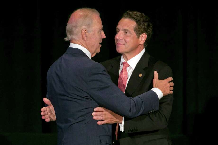 "Vice President Joe Biden, left, New York Gov. Andrew Cuomo, say goodbye after their presentations to the Association for a Better New York luncheon, in New York, Monday, July 27, 2015. Cuomo introduced a plan to redesign and rebuild New York City's LaGuardia airport. The airport in Queens is one of the busiest in the nation, but is cramped and outdated. Vice President Joe Biden last year dubbed it a ""Third World country."" (AP Photo/Richard Drew) ORG XMIT: NYRD112 Photo: Richard Drew / AP"