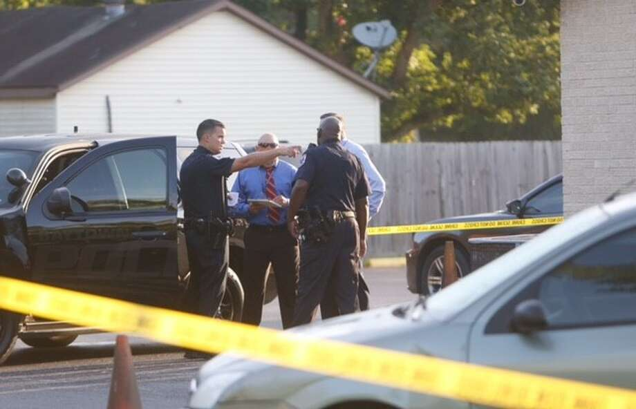 Police investigate after a pastor shot and wounded a burglary suspect at the Church of New Beginnings in Baytown on July 28. Photo: Cody Duty