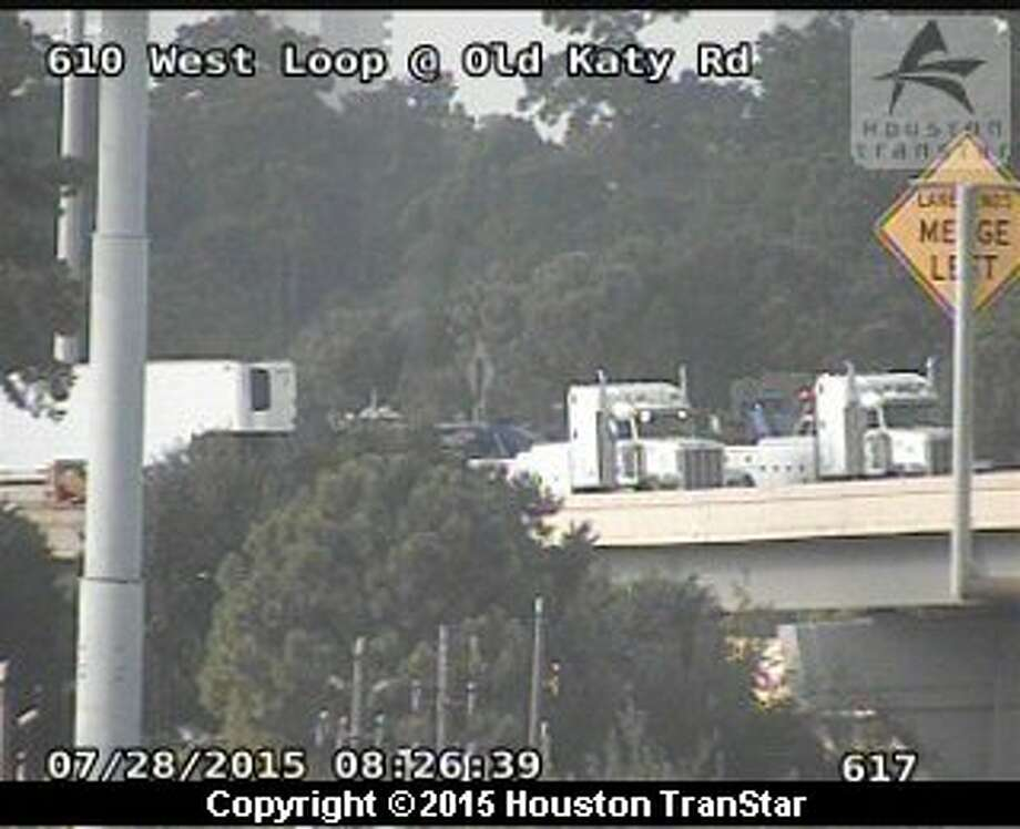 Traffic was snarled early Tuesday morning, July 28, 2015 on portions of Interstate 10 after a big-rig overturned near the 610 Loop just west of downtown. Photo: Houston Transtar