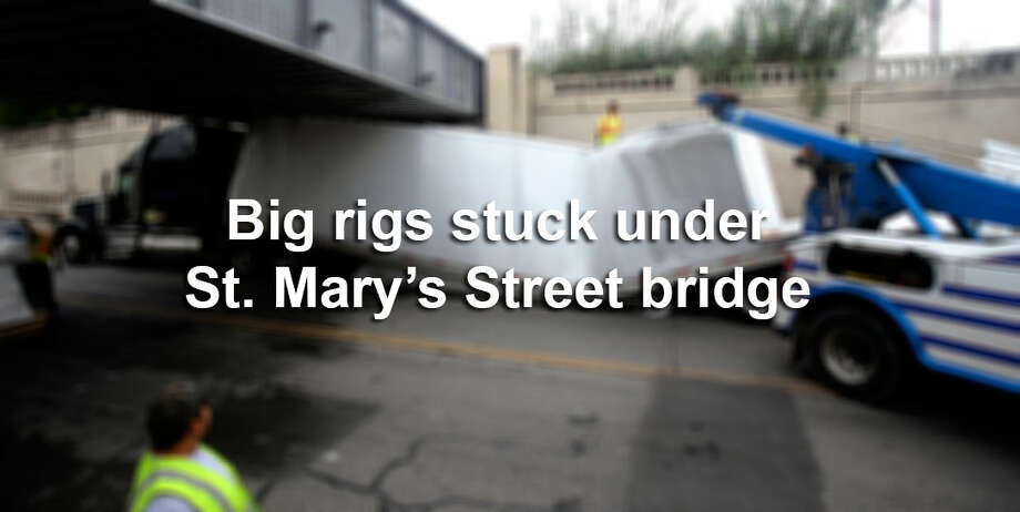 Click through the gallery to see photos of 18-wheelers stuck under St. Mary's Street bridge near Roosevelt Avenue just south of downtown San Antonio. / ©San Antonio Express-News/John Davenport