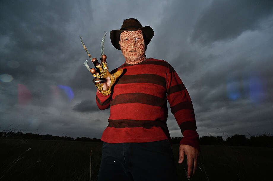 The Haunted Hotel employee Berry Blasisdell, dressed up in a Freddy Krueger Halloween costume stands in a field located in front of Patillo Rd., Beaumont. The Haunted Hotel will be open for one last day this year on Halloween day from 7:13 p.m. till 9:13 p.m. Michael Rivera/The Enterprise