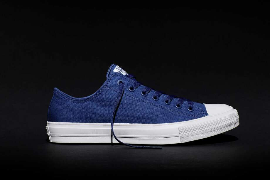 This photo provided by Converse shows the new Fall 2015 Chuck Taylor All Star II blue sneaker, a modern adaptation of the original Chuck Taylor All Star. The new shoe goes on sale July 28, 2015, in black, white, red and blue. (Converse via AP) Photo: HONS / Converse