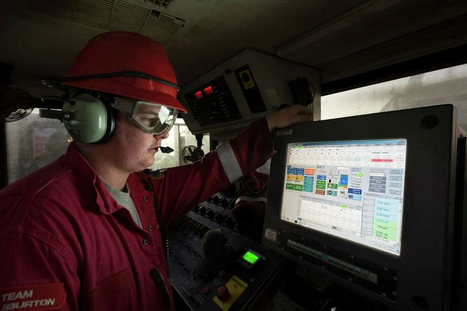 Halliburton employees monitor hydraulic fracturing operations in West Texas. Halliburton Photo: Ken Childress Photography / ©2013 Ken Childress Photography