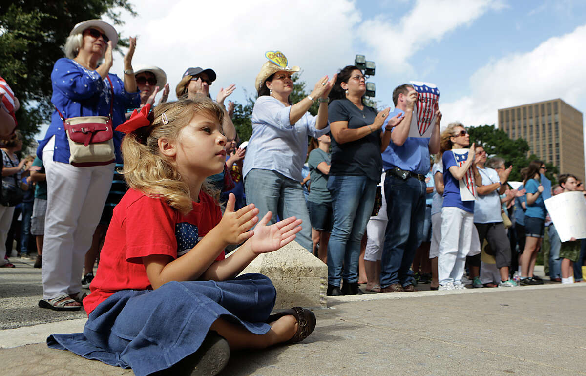 Clarissa Y., her mother didn't want to give last name, age 4 of Austin, sits with a crowd of about 130 supporters of Texas Alliance for Life, as they hold an anti-abortion rally at the Texas Capitol on Tuesday, July 28, 2015, in Austin, Texas.