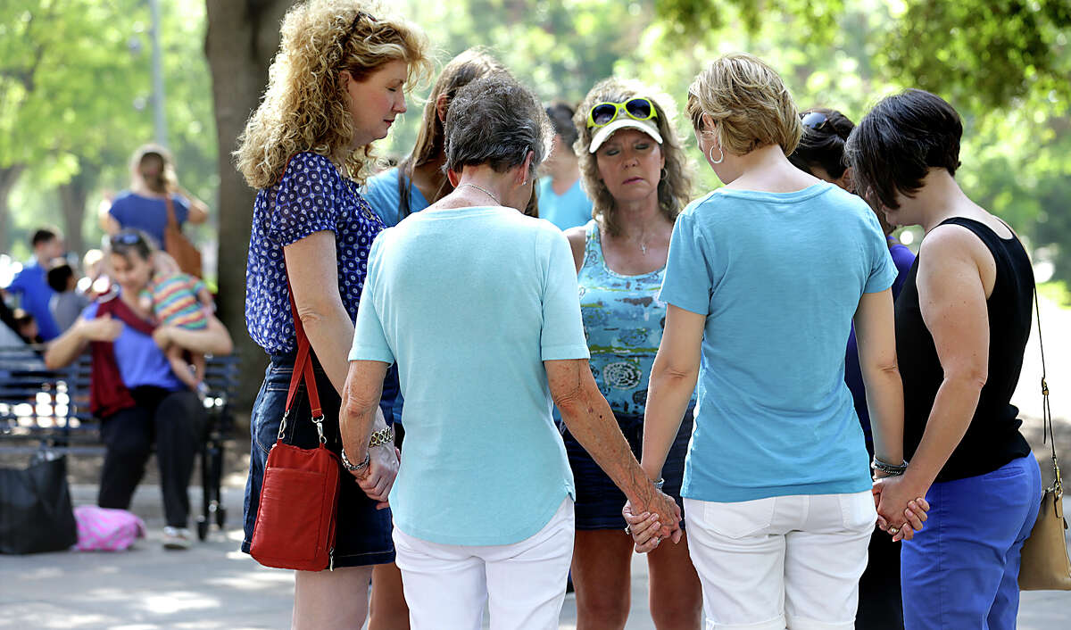 A group of women holding hands, pray together following the Texas Alliance for Life sponsored anti-abortion rally at the Texas Capitol on Tuesday, July 28, 2015, in Austin, Texas.