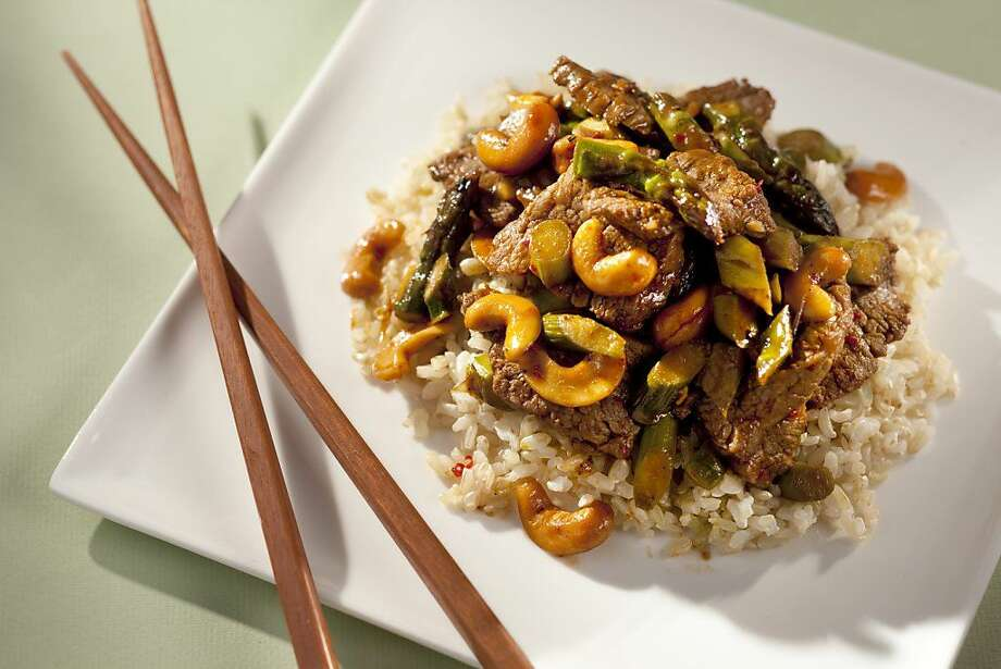 To save time, ask the butcher to cut the flank steak into small, thin slices for this Chili Garlic Beef with Asparagus & Cashews stir-fry. Photo: Craig Lee /Special To The Chronicle