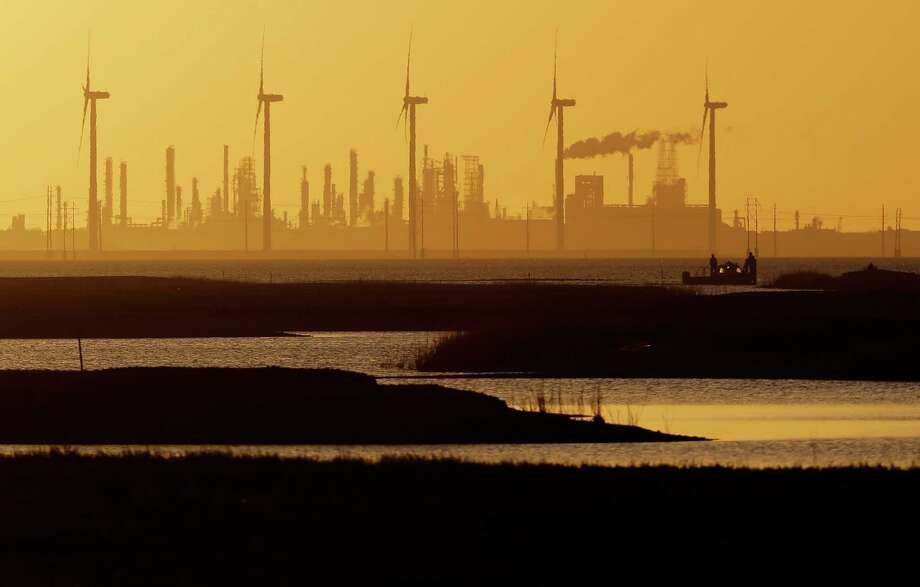 West Coast governors hope to make the sun set on the carbon economy, symbolized by oil refineries. They just signed a Pacific North America Climate Leadership Agreement in San Francisco. British Columbia signed, too, although tying its future to rising LNG, coal and oil exports to Asia. (AP Photo/Eric Gay) Photo: Eric Gay, Getty Images / AP