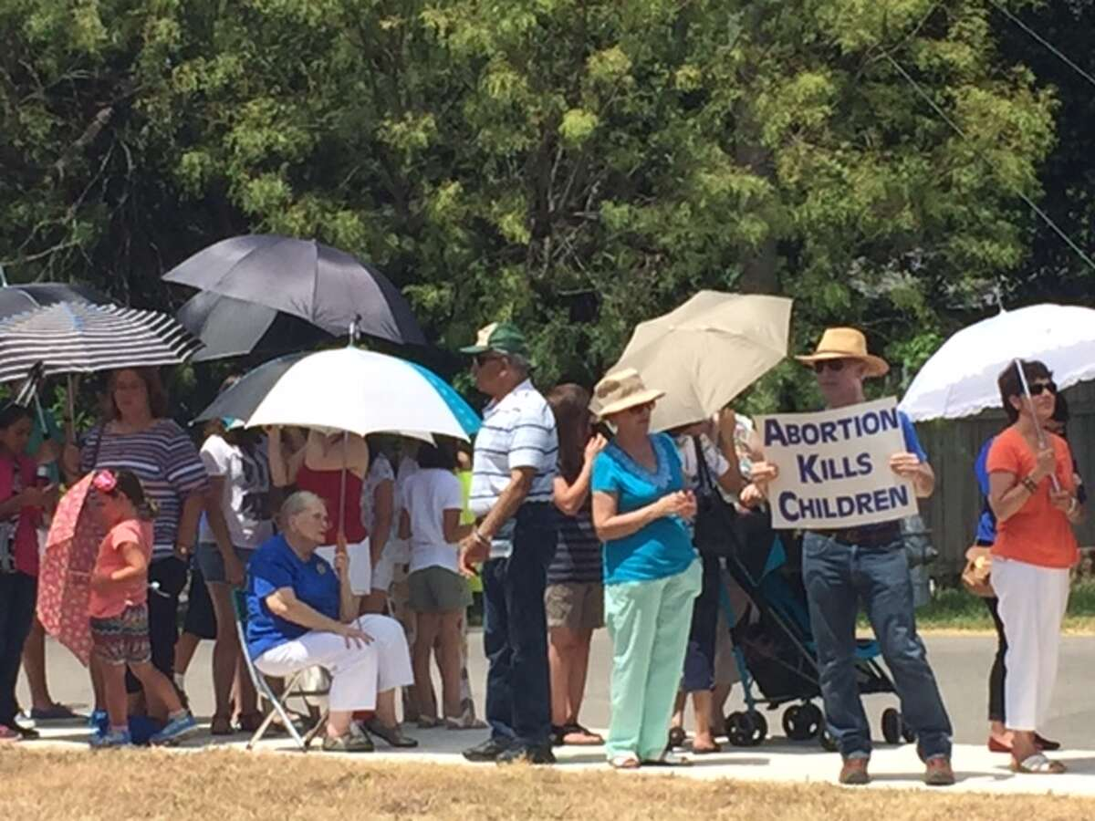 At least 100 anti-abortion protesters have flooded the sidewalk that sits outside of the Planned Parenthood on Babcock Road Tuesday July 28, 2015.