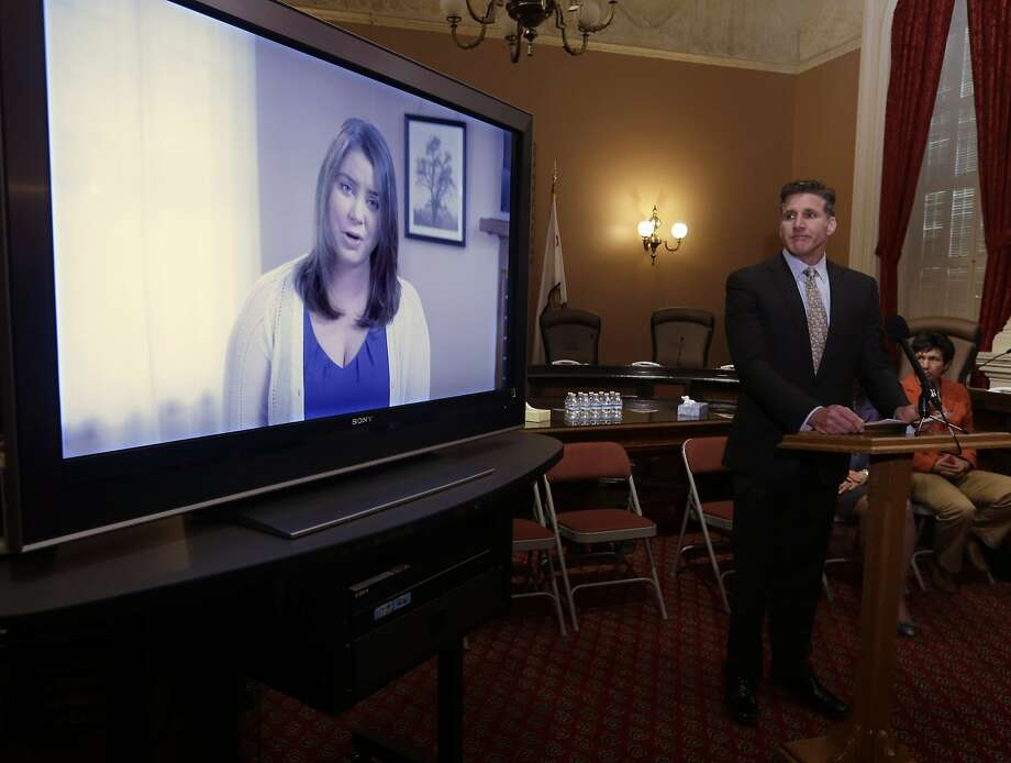 FILE - In this March 25, 2015 file photo, Dan Diaz, the husband of Brittany Maynard, watches a video of his wife, recorded 19 days before her assisted suicide death, where she says that no one should have to leave their home to legally end her life, during a news conference at the Capitol in Sacramento, Calif. The authors of a bill that would allow California physicians  to help terminally ill patents end their lives, Sen. Lois Wolk, D-Davis and Sen. Bill Monning, D-Carmel,  did not present the measure to the Assembly Health Committee as scheduled because it did not have enough votes to advance, Tuesday, July 7, 2015.  Maynard, a 29-year-old San Francisco woman who had terminal brain cancer, moved to Oregon where she could legally end her life.  (AP Photo/Rich Pedroncelli, File) Photo: Rich Pedroncelli, Associated Press
