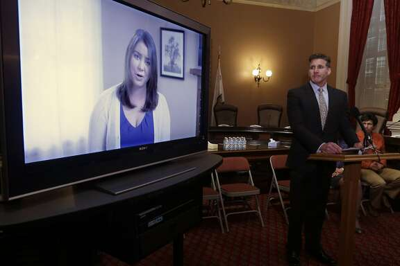 FILE - In this March 25, 2015 file photo, Dan Diaz, the husband of Brittany Maynard, watches a video of his wife, recorded 19 days before her assisted suicide death, where she says that no one should have to leave their home to legally end her life, during a news conference at the Capitol in Sacramento, Calif. The authors of a bill that would allow California physicians  to help terminally ill patents end their lives, Sen. Lois Wolk, D-Davis and Sen. Bill Monning, D-Carmel,  did not present the measure to the Assembly Health Committee as scheduled because it did not have enough votes to advance, Tuesday, July 7, 2015.  Maynard, a 29-year-old San Francisco woman who had terminal brain cancer, moved to Oregon where she could legally end her life.  (AP Photo/Rich Pedroncelli, File)