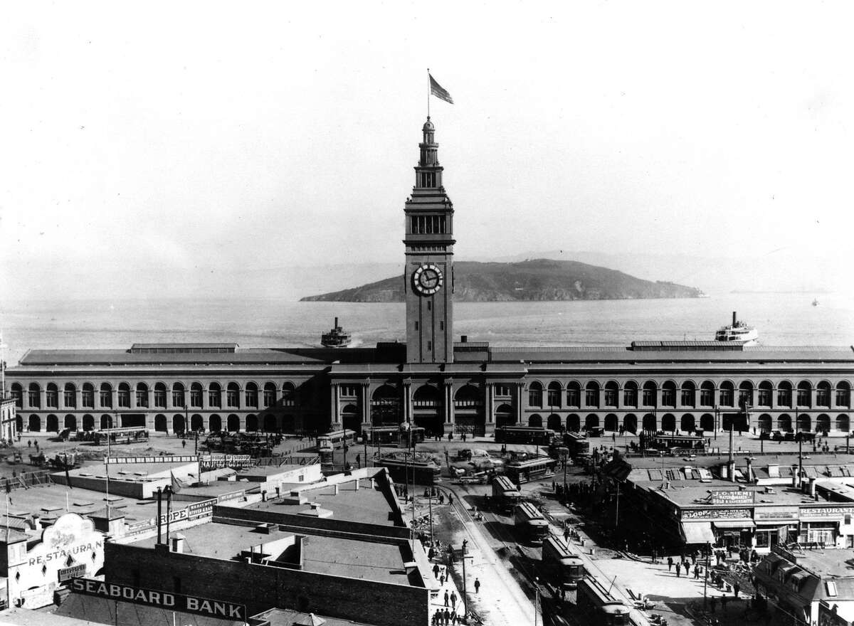 The 20s: San Francisco Ferry Building during one of its peaks as a ferry terminal. In the 1920s, more than 100,000 commuters passed through the Ferry Building each day.
