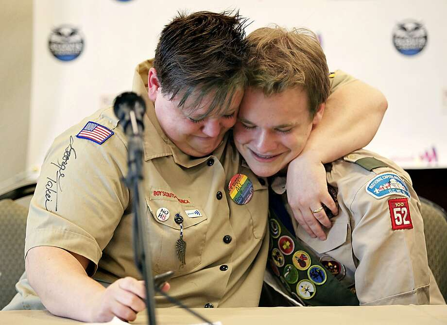 Jennifer Tyrrell hugs Pascal Tessier in Grapevine, Texas. Jennifer was kicked out as a den leader in 2012 for being openly gay. Photo: Stewart  F. House
