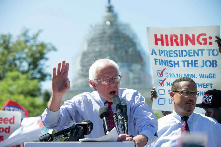 Democratic presidential candidate Sen. Bernie Sanders, I-Vt., joined by federal contract workers, speaks during a rally on Capitol Hill in Washington on Wednesday. Photo: Andrew Harnik / Associated Press / AP