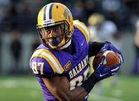 UAlbany's Cole King carries the ball during their football game against Delaware on Saturday, Nov. 8, 2014, at Bob Ford Field in Albany, N.Y. (Cindy Schultz / Times Union)