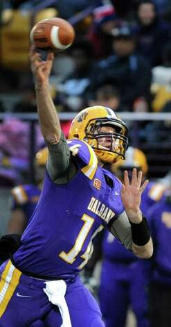 UAlbany's quarterback Will Fiacchi throws a pass during their football game against Delaware on Saturday, Nov. 8, 2014, at Bob Ford Field in Albany, N.Y. (Cindy Schultz / Times Union) Photo: Cindy Schultz / 00029366A