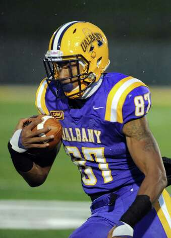 UAlbany's Cole King carries the ball during their football game against Stony Brook  on Saturday, Nov. 22, 2014, at Bob Ford Field in Albany, N.Y. (Cindy Schultz / Times Union) Photo: Cindy Schultz / 00029589A