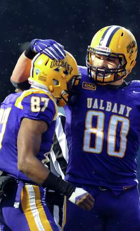 UAlbany's Cole King, left, celebrates a touchdown with Brian Parker during their football game against Stony Brook  on Saturday, Nov. 22, 2014, at Bob Ford Field in Albany, N.Y. (Cindy Schultz / Times Union) Photo: Cindy Schultz / 00029589A