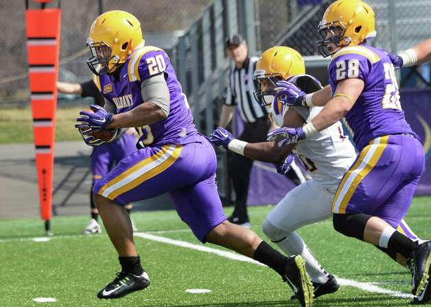Running back #20 Andre Martin, left, scores a TD during UAlbany football's Spring Game Saturday April 18, 2015 in Albany, NY.  (John Carl D'Annibale / Times Union) Photo: John Carl D'Annibale / 00031485A