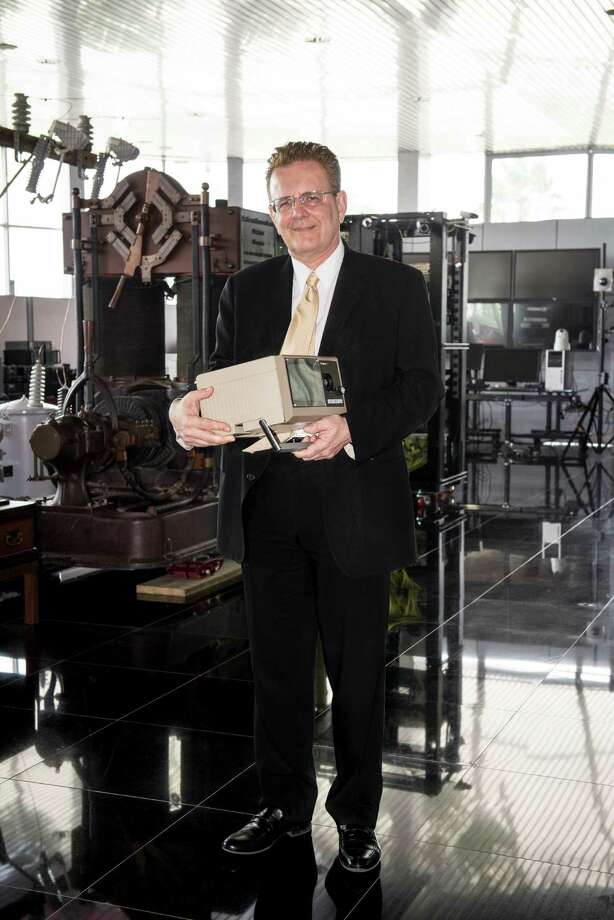 San Antonio tech pioneer David Monroe holds an early version of an image transmission system, the invention on which he based his company, Photophone Ltd., in 1983. Photo: Matthew Busch /For San Antonio Express-News / © Matthew Busch