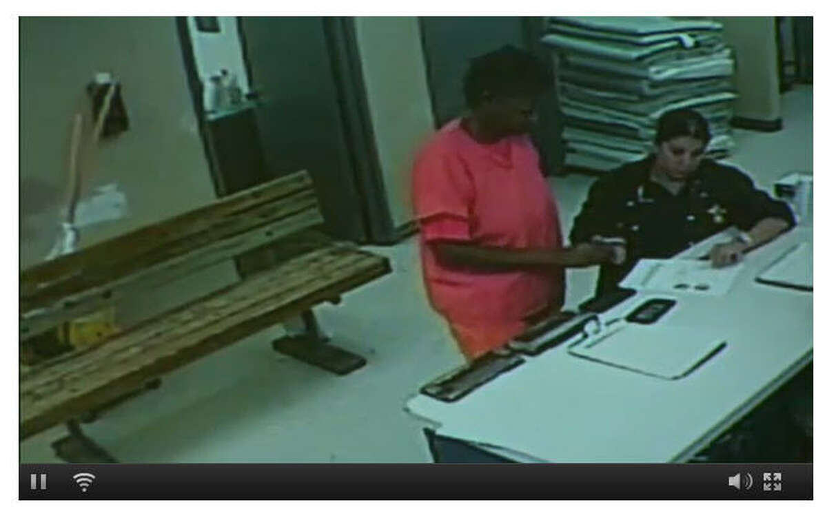 Sandra Bland, in orange jumpsuit, during a second suicide screening inside the jail. Bland would be found dead inside her jail cell later.