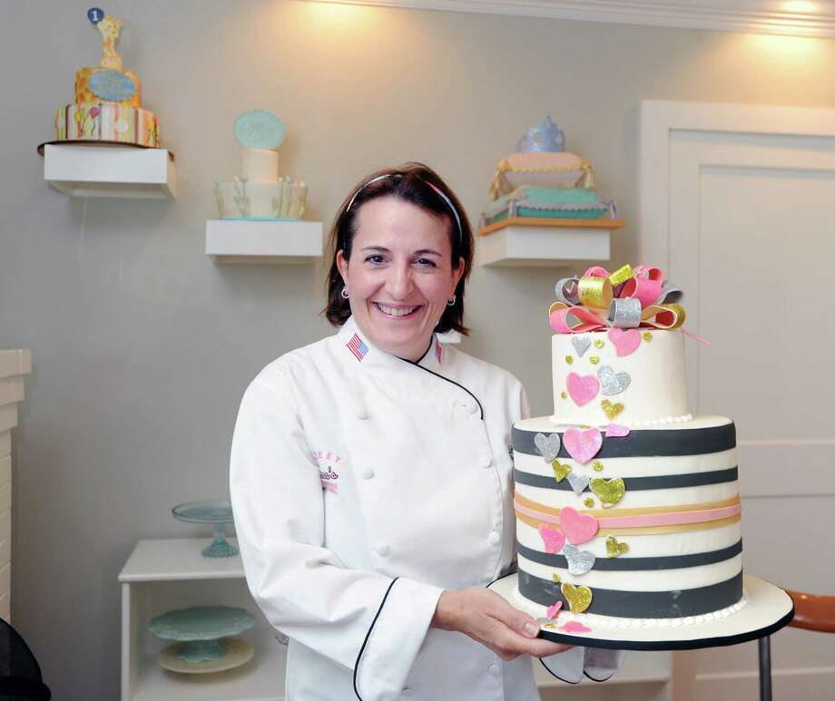 Lisa Maronian, co-owner of Sweet Lisa's Exquisite Cakes, with a model of a heart cake in her shop located in the Cos Cob section of Greenwich, Conn., Tuesday, July 28, 2015. Photo: Bob Luckey Jr. / Hearst Connecticut Media / Greenwich Time