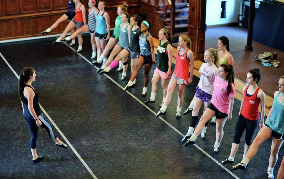 Former Riverdance cast member Meghan Lucey, left, teaches a class during Camp Rince Ceol Irish Dance Camp at Union College Tuesday July 28, 2015 in Schenectady, NY.  (John Carl D'Annibale / Times Union) Photo: John Carl D'Annibale / 00032741A