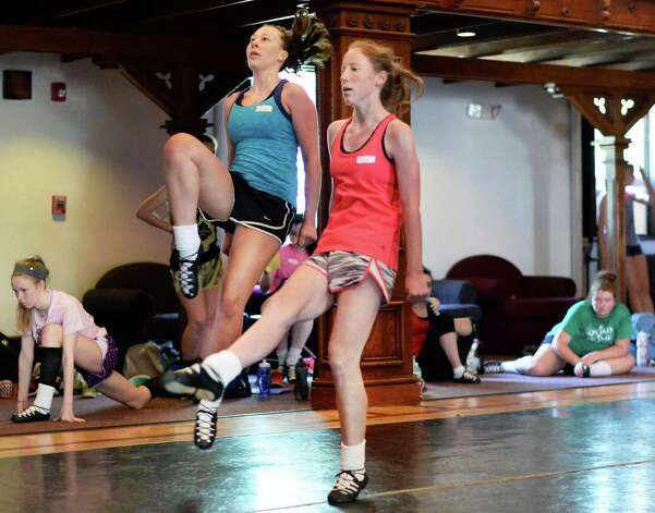 Dance students Stephanie Crispell, left, 16, of Ellicott City, Maryland and Brittany Babbington, 16, of Annapolis, Maryland, perform during a class at Camp Rince Ceol Irish Dance Camp at Union College Tuesday July 28, 2015 in Schenectady, NY.  (John Carl D'Annibale / Times Union) Photo: John Carl D'Annibale / 00032741A