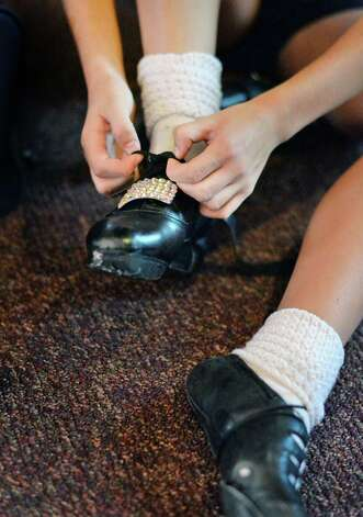 A dance student changes shoes during Camp Rince Ceol Irish Dance Camp at Union College Tuesday July 28, 2015 in Schenectady, NY.  (John Carl D'Annibale / Times Union) Photo: John Carl D'Annibale / 00032741A