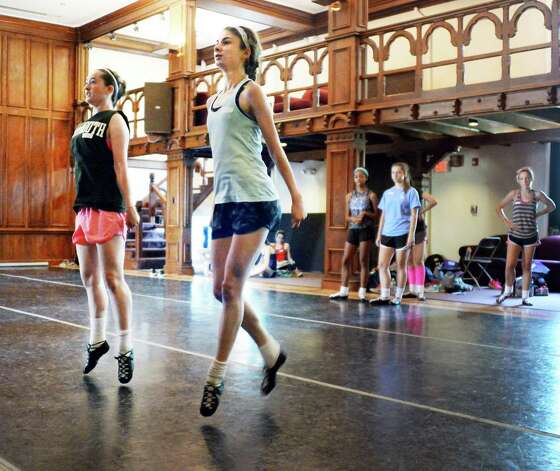 Dance students Fiona Dubrosa,left, 16, of Westchester and   Aidan Moroz, 18, of Warrington, Penn., take their turn during Camp Rince Ceol Irish Dance Camp at Union College Tuesday July 28, 2015 in Schenectady, NY.  (John Carl D'Annibale / Times Union) Photo: John Carl D'Annibale / 00032741A