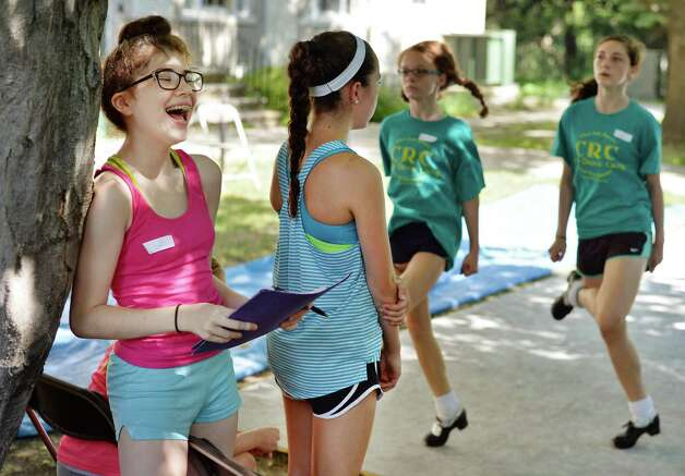 Dance student Caitlin Dalton, left, 13, of Clifton, NJ finds a light moment during Camp Rince Ceol Irish Dance Camp at Union College Tuesday July 28, 2015 in Schenectady, NY.  (John Carl D'Annibale / Times Union) Photo: John Carl D'Annibale / 00032741A