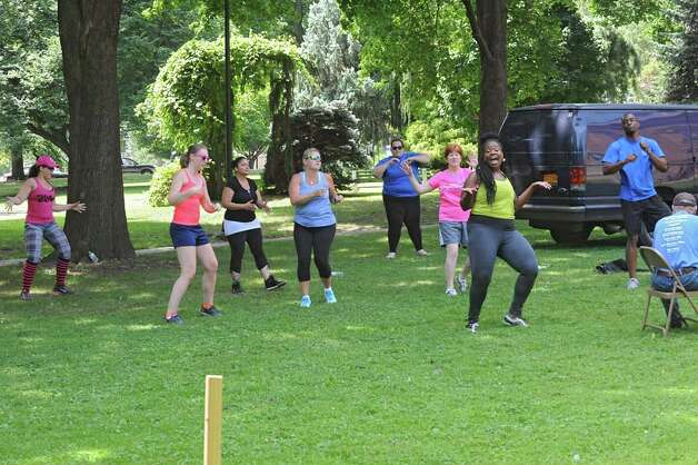 Instructor Cassandra Carter leads a free Zumba class as part of Department of Recreation's 1609 Challenge at Academy Park on Tuesday, July 28, 2015 in Albany, N.Y.  Albany Mayor Kathy Sheehan also participated. (Lori Van Buren / Times Union) Photo: Lori Van Buren, Albany Times Union
