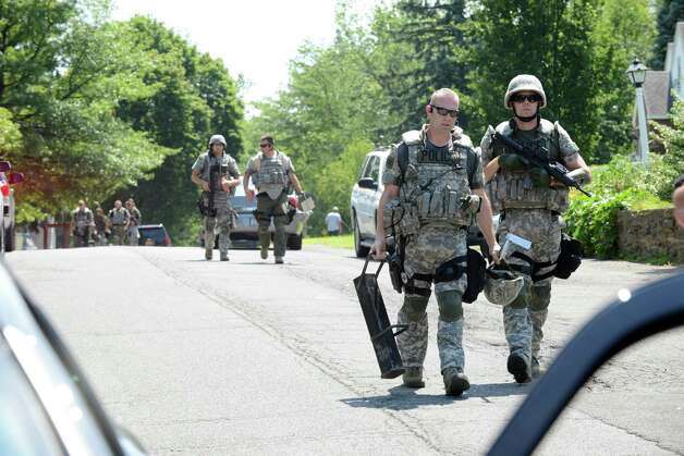 Colonie Police officers leave the scene of an apparent suicide at 15 Hoffman Dr. Tuesday afternoon, July 28, 2015, in Colonie, N.Y. (Will Waldron/Times Union)