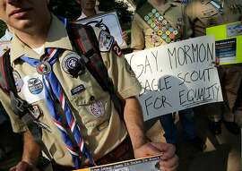 "FILE - JULY 27, 2015: According to reports, the governing board of the Boy Scouts of America has voted to end its ban on gay troop leaders and employees. WASHINGTON, DC - MAY 22:  Members of Scouts for Equality hold a rally to call for equality and inclusion for gays in the Boy Scouts of America as part of the ""Scouts for Equality Day of Action"" May 22, 2013 in Washington, DC. The Boy Scouts of America is scheduled to hold a two day meeting tomorrow with 1,400 local adult leaders to consider changing its policy of barring openly gay teens from participating in the Boy Scouts.  (Photo by Win McNamee/Getty Images)"