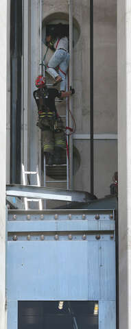 14 people rescued from stalled elevator at Tower of the