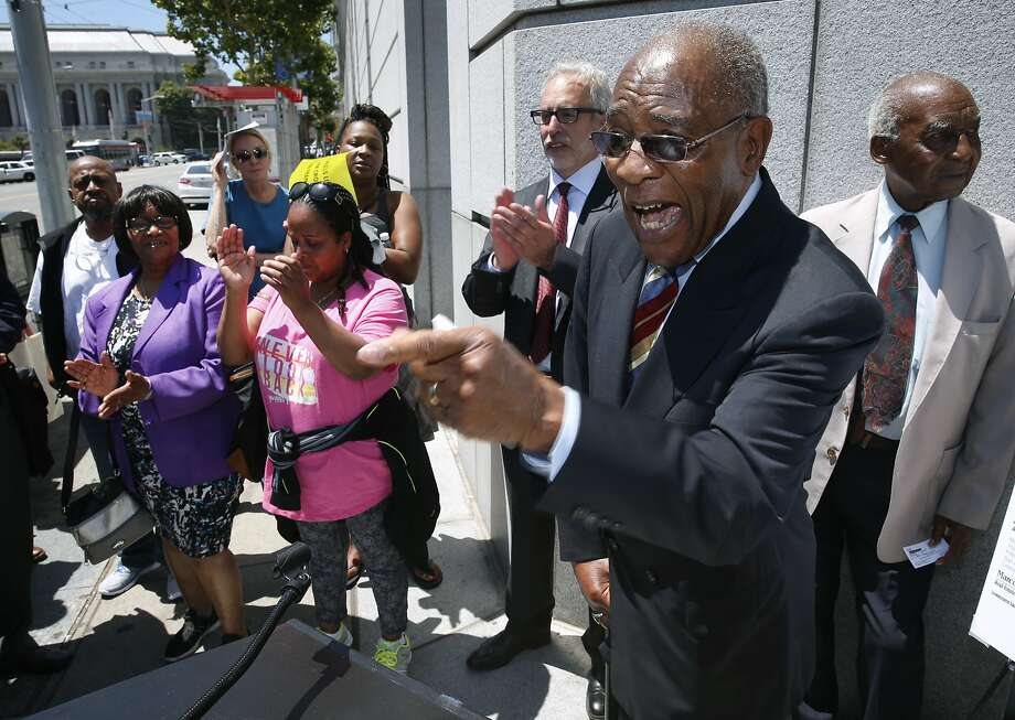 Rev. Amos Brown, pastor of the Third Baptist Church, comments at a news conference outside of the SF Superior Courthouse in San Francisco, Calif. on Tuesday, July 28, 2015. Attorneys for the church asked a Superior Court judge to issue a restraining order against the landlord of the Frederick Douglas Haynes Gardens low income apartments from selling the property to speculators. Photo: Paul Chinn, The Chronicle
