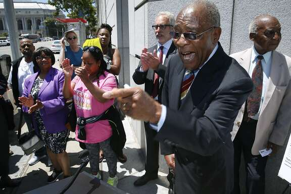 Rev. Amos Brown, pastor of the Third Baptist Church, comments at a news conference outside of the SF Superior Courthouse in San Francisco, Calif. on Tuesday, July 28, 2015. Attorneys for the church asked a Superior Court judge to issue a restraining order against the landlord of the Frederick Douglas Haynes Gardens low income apartments from selling the property to speculators.