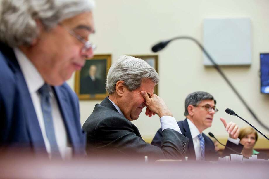 Secretary of State John Kerry, center, accompanied by Secretary of Treasury Jack Lew, right, and Secretary of Energy Ernest Moniz, left, appears before a House Foreign Affairs Committee hearing Tuesday in Washington, on the Obama administration's case for the Iran nuclear deal. (AP Photo/Andrew Harnik) Photo: Andrew Harnik, STF / AP