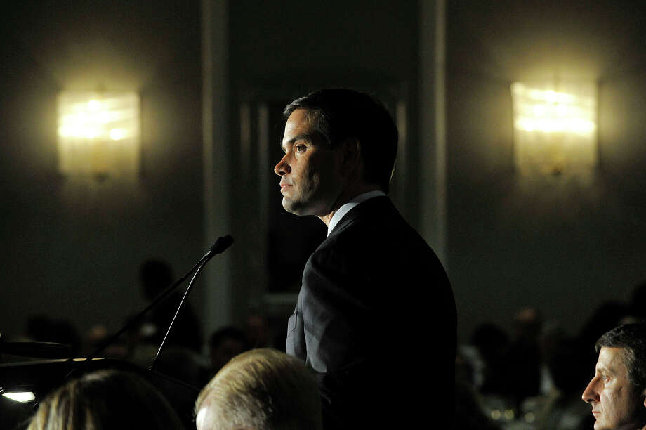 Florida U.S. Senator and Republican presidential candidate Marco Rubio gives the keynote address at the Prescott Bush Dinner at the Crowne Plaza in Stamford, Conn., on Thursday, June 4, 2015. Watching in the background, right, is then-state GOP boss, Jerry Labriola Jr. Photo: Jason Rearick / Jason Rearick / Stamford Advocate