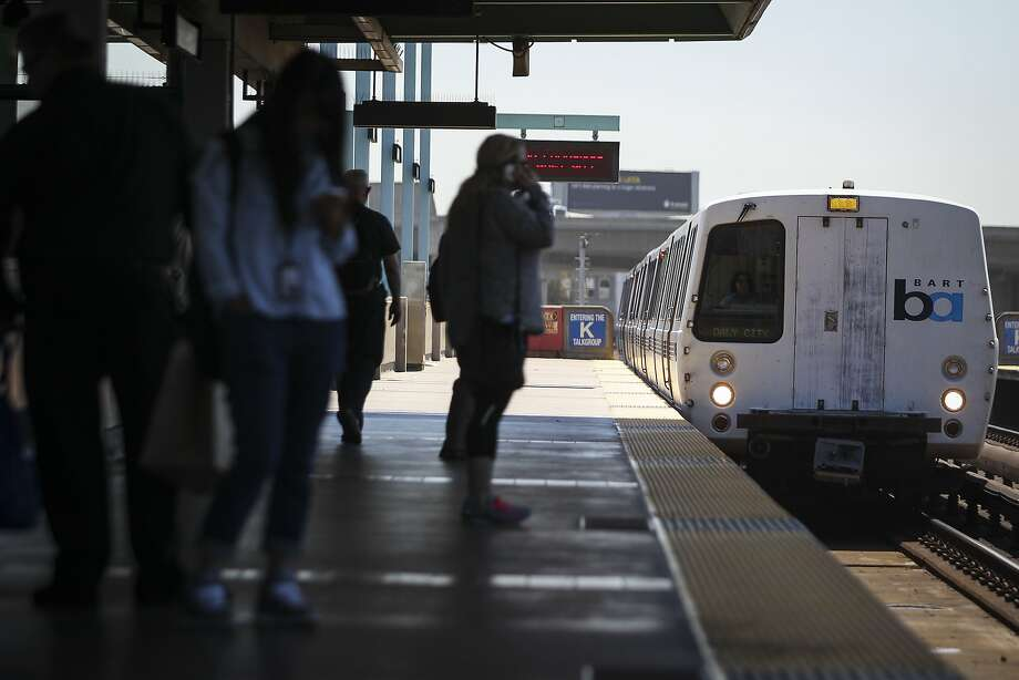 BART riders wait for a train at the West Oakland Station on Tuesday, July 28, 2015. The Transbay Tube will be closed this weekend, with service between West Oakland and Embarcadero stations stopped to allow track maintenance. Photo: Loren Elliott, The Chronicle